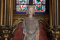 Detail of statue of Saint Louis (King Louis IX of France) in the lower chapel of La Sainte-Chapelle (The Holy Chapel), 1248, Paris, France. La Sainte-Chapelle was commissioned by King Louis IX to house his collection of Passion Relics, including the Crown of Thorns. The Sainte-Chapelle is considered among the highest achievements of the Rayonnant period of Gothic architecture. Picture by Manuel Cohen