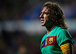 FC Barcelona's Carles Puyol gestures during the Spanish league football match Levante UD vs FC Barcelona on April 14, 2012 at the Ciudad de Valencia Stadium in Valencia. (Photo by Xaume Olleros/Action Plus)