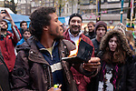 Protestor burns his passport at the Occupy Amsterdam demonstration, outside the Amsterdam Stock Exchange, Beursplein. It's not clear if the passport - which appeared to be Australian - was real, valid, or the man's own. This is one of many 'occupy' protests fallowing the Occupy Wall Street protests in New York, against economic inequality. October 19th 2011. Copyright 2011 Dave Walsh, davewalshphoto.com