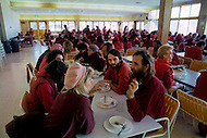 Wasco, Oregon, February 1984: Disciples of Bhagwan Rajneesh, having a meal together in the community lunchroom.  Rajneeshpuram, was an intentional community in Wasco County, Oregon, briefly incorporated as a city in the 1980s, which was populated with followers of the spiritual teacher Osho, then known as Bhagwan Shree Rajneesh. The community was developed by turning a ranch from an empty rural property into a city complete with typical urban infrastructure, with population of about 7000 followers.