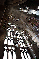 Interior of Nativity façade constructed by Gaudí besides new ramified columns of the naves, La Sagrada Familia, Roman Catholic basilica, Barcelona, Catalonia, Spain, built by Antoni Gaudí (Reus 1852 ? Barcelona 1926) from 1883 to his death. Still incomplete. Picture by Manuel Cohen