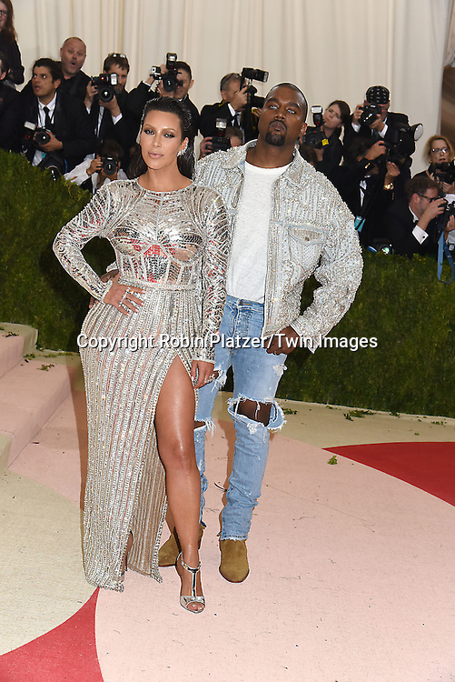 Kim Kardashian and Kanye West attend the Metropolitan Museum of Art Costume Institute Benefit Gala on May 2, 2016 in New York, New York, USA. The show is Manus x Machina: Fashion in an Age of Technology. <br /> <br /> photo by Robin Platzer/Twin Images<br />  <br /> phone number 212-935-0770