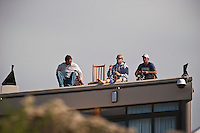 Pancho Sullivan (HAW) Mick Fanning (AUS) and Nathan Hedge (AUS) watch the contest from the roof of theri apartment. Fanning defeated Taj Burrow (AUS) in the final of the 2006 Billabong Pro at Jeffreys Bay, Eatern Cape, South Africa. Photo: joliphotos.com