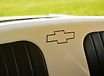Old Westbury, New York, U.S. - June 1, 2014 - Chevy emblem is in outline on black and white rear seat of 1955 Chevrolet Belair, owned by PETER VENZA of WOODHAVEN, which is an entry at the Antique and Collectible Auto Show held on the historic grounds of elegant Old Westbury Gardens in Long Island, and sponsored by Greater New York Region AACA Antique Automobile Club of America.