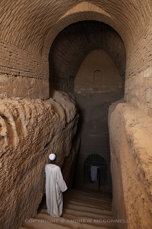 The entrance to the tomb of Qalhata, mother of King Tanwetamani, pictured on Tuesday, March 27, 2007. The tomb is part of the royal cemetery at El Kurru of which little is known. The earliest tombs date from the 9th century BC, it is thought that El Kurru was an early capital of Kush before moving to nearby Jebel Barkal.   ..The ancient kingdom of Kush emerged around 2000 BC in the land of Nubia, what is today northern Sudan. At their height the Nubians ruled over ancient Egypt as the 25th Dynasty between 720 BC and 664 BC (known as the Black Pharaohs) and saw their borders reach to edges of Libya and Palestine. The Kushite kings saw themselves as guardians of Egyptian religion and tradition. They centered there kindgom on the Temple of Amun at Napata (modern day Jebel Barkal) and brought back the building of Pyramids in which to inter their kings - there are around 220 pyramids in Sudan, twice the number in Egypt. After Napata was sacked, by a resurgent Egypt, the capital was moved to Meroe where a more indigenous culture developed, Egyptian hieroglyphics made way for a cursive Meroitic script, yet to be deciphered. The Meroitic kingdom eventually fell into decline in the 3rd century AD with the arrival of Christianity.