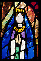 A stained glass image of the Virgin of Guadalupe decorates the  door of a church in Ajo, Arizona