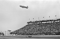 INDIANAPOLIS, IN - MAY 29: With a Goodyear blimp overhead, Al Unser drives his Parnelli VPJ6B 001/Cosworth TC on his way to a third place finish in the Indianapolis 500 on May 29, 1977, at the Indianapolis Motor Speedway in Indianapolis, Indiana.