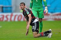 FUSSBALL WM 2014  VORRUNDE    GRUPPE G    in Recife USA - Deutschland                  26.06.2014 Thomas Müller (Deutschland) am Boden