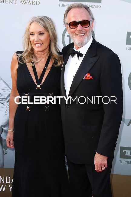 HOLLYWOOD, LOS ANGELES, CA, USA - JUNE 05: Margaret DeVogelaere, Peter Fonda at the 42nd AFI Life Achievement Award Honoring Jane Fonda held at the Dolby Theatre on June 5, 2014 in Hollywood, Los Angeles, California, United States. (Photo by Xavier Collin/Celebrity Monitor)