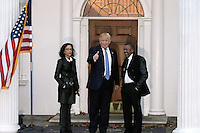 Founder of BET Television, Robert Johnson (R) poses  with United States President-elect Donald Trump and an unidentified woman at the clubhouse of Trump International Golf Club, in Bedminster Township, New Jersey, USA, 20 November 2016.<br /> Credit: Peter Foley / Pool via CNP /MediaPunch