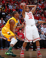 Ohio State Buckeyes guard Lenzelle Smith Jr. (32) is guarded by North Dakota State Bison guard Kory Brown (22) during the first half of Saturday's NCAA Division I basketball game at Value City Arena in Columbus on December 14, 2013.(Barbara J. Perenic/The Columbus Dispatch)