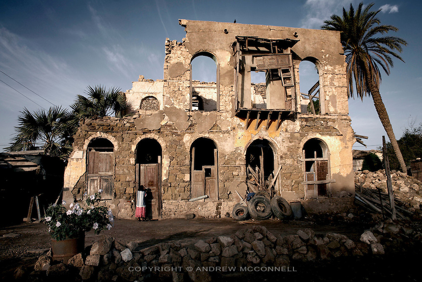A house which was bombed during the Struggle for Independence still serves as a home in the town of Massawa, Eritrea..