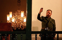 Cuban president Fidel Castro greets a crowd of supporters in a square in Santiago de Cuba Friday for a speach in honor of the 40th anniversary of the Cuban revolution. Castro spoke on the balcony where he addressed the citizens of Santiago 40 years earlier.