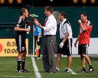 D.C. United head coach Curt Onalfo talks to forward (7) Adam Cristman at RFK Stadium in Washington, DC.  The New York Red Bulls defeated D.CC United, 2-0.