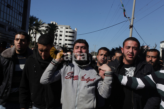 """Palestinian mourners carry the body of an Islamic Jihad militant who was killed by in what medics and his family said was an Israeli drone strike mourn during his funeral in Gaza City on January 8, 2014. Mohammed al-Ijlah, 32, was """"killed by an Israeli drone in Shejaiyeh,"""" said Ashraf al-Qudra, spokesman for the Hamas-run health ministry, referring to a district near the Israeli border with Gaza. Israeli military denied carrying out any strike on Gaza, with a spokeswoman saying she was unaware of any such incidents in the area. Photo by Ashraf Amra"""