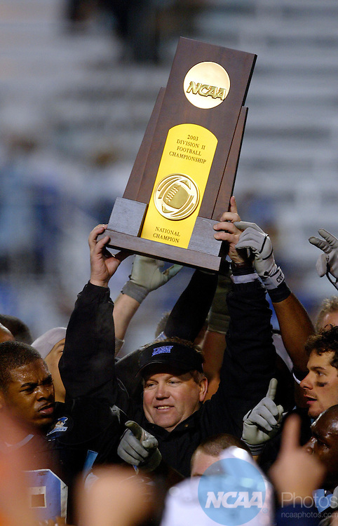 13 DEC 2003:  Grand Valley State University Head Coach Brian Kelly raises the championship trophy in the air after defeating the University of North Dakota during the Division II Men's Football Championship held at Braly Municipal Stadium in Florence, AL.  Grand Valley State defeated North Dakota 10-3 for the national title.  Jamie Schwaberow/NCAA Photos