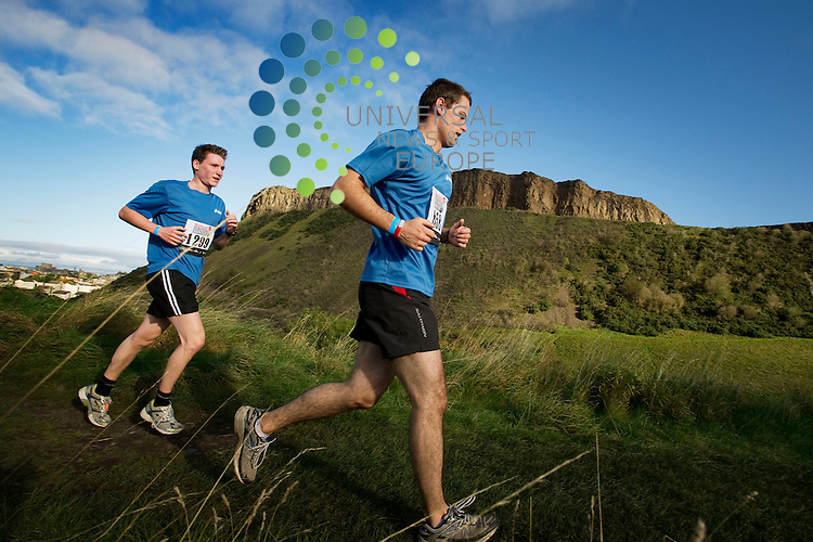 Competitors in the Mens Health Survival of the Fittest challenge make their way through Holyrood Park in Edinburgh, navigating a slide obstacle as they go, Edinburgh, Scotland, 16th October, 2011.Picture:Scott Taylor Universal News And Sport (Europe) .All pictures must be credited to www.universalnewsandsport.com. (Office)0844 884 51 22.