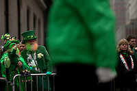Revelers watch the parade on Fifth Avenue during the 252nd annual St. Patrick's Day Parade in New York City. Photo by Eduardo Munoz Alvarez / VIEWpress.