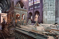 Transept with the gisants of Louis of France (d. 1260), Philip of France (d. 1235), 13th century, stone and p&acirc;te de verre, origine Abbey of Royaumont, displayed to Saint Denis in 1817; funerary monument of Louis XII and Anne of Brittany, funerary monument of Dagobert on the opposite side of the central nave, Abbey church of Saint Denis, Seine Saint Denis, France. Picture by Manuel Cohen