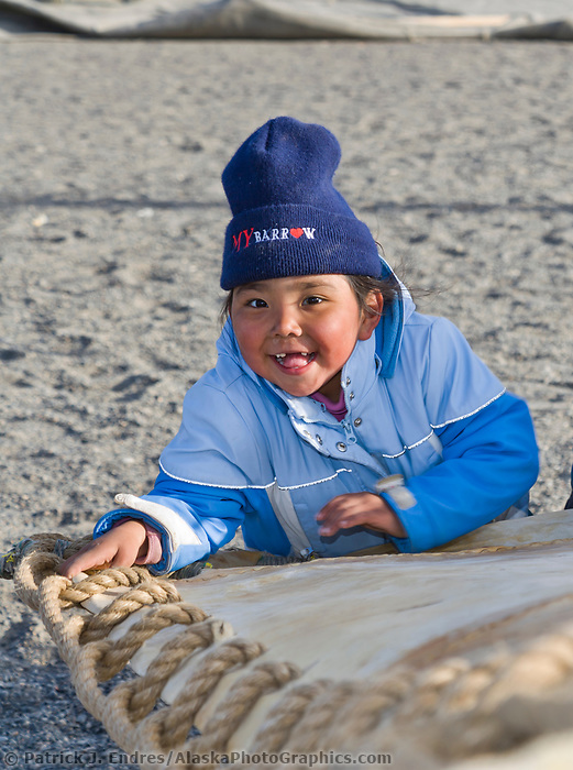 Native Alaskan Inupiaq children play during the Nalukataq festival, held to celebrate the successful subsistence whale hunt in Utqiagvik (Barrow), Alaska.
