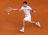 Novak DJOKOVIC (SRB) against Stanlinas WAWRINKA (SUI) in the third round. Novak Djokovic beat Stanlinas Wawrinka 6-4 6-4..International Tennis - 2010 ATP World Tour - Masters 1000 - Monte-Carlo Rolex Masters - Monte-Carlo Country Club - Alpes-Maritimes - France..© AMN Images, Barry House, 20-22 Worple Road, London, SW19 4DH.Tel -  + 44 20 8947 0100.Fax - + 44 20 8947 0117
