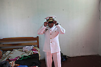 Bolivian Navy Captain Alferez Juan Carlos Calmani gets dressed to receive president Evo Morales at the naval base in Puerto Quijarro. Bolivia lost what is now northern Chile in a war over nitrates leaving Bolivia without access to the ocean.