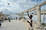 A boy who survived Haiti's devastating January 12 earthquake flies a kite in a camp for homeless families in the Belair section of Port-au-Prince.