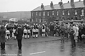 "The ""Nutters' Dance"", Bacup, Lancashire  1973.  On Easter Saturday every year the ""Coco-nut"" dancers gather at one boundary of the town and dance their way across to the other accompanied by members of the Stackstead Silver Band, collecting for charity as they go."