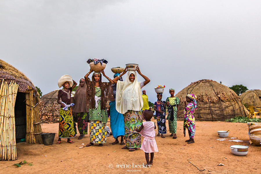 Fulani women carrying gifts to the bride's family. Scene from a Fulani marriage ceremony. Kajuru, North-western Nigeria.