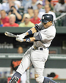 New York Yankees centerfielder Curtis Gunderson (14) bats in the eighth inning against the Baltimore Orioles at Oriole Park at Camden Yards in Baltimore, MD on Friday, August 26, 2011.  The Orioles won the game 12 - 5..Credit: Ron Sachs / CNP.(RESTRICTION: NO New York or New Jersey Newspapers or newspapers within a 75 mile radius of New York City)