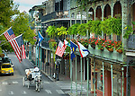 Horse and carriage tours on Royal Street are a popular way for tourists to enjoy the architecture and ambience of New Orleans historic French Quarter.