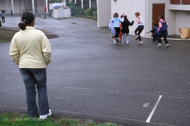 Berkeley CA 5th grade minority girl being left out of classmates' play on school playground at recess