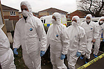 JAMES BOARDMAN / 07967642437 - 01444 412089.A police search team enter a house in Tonbridge Wells, Kent that was raided on the weekend in connection with the multi-million pound robbery in Tonbridge.