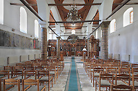 Nave of the Church of St Spiridon, 18th - 19th centuries, completed 1864, in the Gorica quarter of Berat, South-Central Albania, capital of the District of Berat and the County of Berat. The church is a 3-nave basilica with two lower side naves and a bell tower. Here we see the wooden iconostasis covering the whole length in front of the entrance to the altar area. Picture by Manuel Cohen
