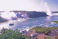 Niagara Falls ('American Falls' in USA and Canadian 'Horseshoe Falls') and the Niagara River, in the City of Niagara Falls, Ontario, Canada - 'Maid of the Mist' Boat Tour Launch Site below (Natural Wonder of the World)