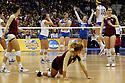 Florida State's Visnja Djurdjevic, bottom center, gets up after match point as UCLA's Rachael Kidder (11), Lainey Gera (06) and Mariana Aquino (12) celebrate during game action of the 2011 NCAA Division I Women's Volleyball Championship National Semifinal Match #1 at the Alamodome on Thursday, Dec. 15, 2011.