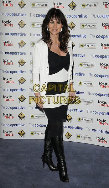 """LINDA LUSARDI.The film premiere of """"Dirty Oil"""", Barbican Centre, London, England.March 15th 2010.full length black white striped stripes  dress tights cardigan knee high boots velvet .CAP/CAN.©Can Nguyen/Capital Pictures."""