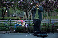 A man plays trumpet next to his daughter during the Spring arrival in New York.  United States. 04/16/2012. Photo by Eduardo Munoz Alvarez / VIEWpress.