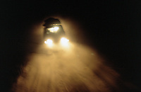 Angola. Cuando Cubango. A team from MSF (M?decins Sans Frontires) Switzerland drives back to Mavinga at night on a sandy roadtrack in an off road vehicle, a fourwheel drive Toyota Landcruiser . © 2002 Didier Ruef