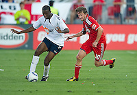 21 July 2010:   Bolton Wanderers midfielder Fabrice Muamba No. 6 and Toronto FC forward Mista No. 10 in action during the Carlsberg Cup game between the Bolton Wanderers and Toronto FC at BMO Field in Toronto..Bolton Wanderers FC  won on penalties.