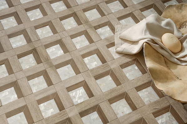 Paseo, a handmade mosaic shown in polished Driftwood, honed Whitewood, and Shell, is part of the Illusions™ Collection by Sara Baldwin Designs and Paul Schatz for New Ravenna.