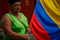 A woman carries a flag while residents celebrated the Colombia's 202th Independence Day parade in Tamesis, July 20, 2012. Photo by Kena Betancur / VIEW.