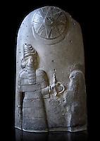 Basalt Babylonian sculpture reporting the spoils of war, 12th cent.BC. The Louvre Museum, Paris.