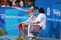August 23, 2008; Beijing, China; Rhythmic gymnast Anna Bessonova of Ukraine celebrates score on ribbon with coach Albina Deriugina on way to winning bronze in the All-Around final at 2008 Beijing Olympics..(©) Copyright 2008 Tom Theobald