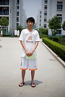 Hupeng, a student, age 22, poses for a portrait in Nanjing. Response to 'What does China mean to you?': 'China is my ancestral land. The place I was born, raised and grew up.'  Response to 'What is your role in China's future?': 'Although I am just one small person out of the large Chinese population, every person is responsible for the duty of strengthening ancestors and descendants.'