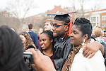 Engineering student Rochard Dument  celebrates garudation with his family following fall commencement. Photo by Ben Siegel