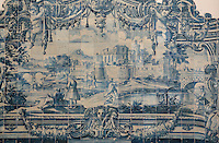 The history of the monastery and the Siege of Lisbon in 1147, traditional blue and white azulejos tile scene with decorative border, 18th century, in the Monastery of Sao Vicente de Fora, an Augustinian order monastery and church built in the 17th century in Mannerist style, Lisbon, Portugal. The monastery also contains the royal pantheon of the Braganza monarchs of Portugal. Picture by Manuel Cohen