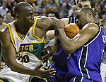 Seattle SuperSonics' Reggie Evans, L, tries to wrestle the ball away from Sacramento Kings' Kenny Thomas in the fourth period of their first round playoff game at Key Arena in Seattle, Washington Saturday, 23 April  2005. The Sonics beat the Kings 87-82.. Jim Bryant Photo. &copy;2010. All Rights Reserved.