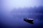 Row boat on Lake Mason, sunrise in fog, Olympic Penninsula, Washington State USA..
