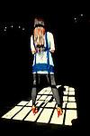 Woman stands in window light on stone floor